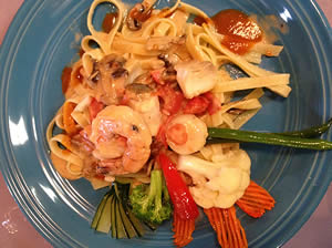 Seafood Special  Salmon, shrimp & scallops in a lobster sauce over fettuccini