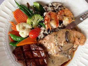 Filet and grilled chicken breast with mushroom sauce